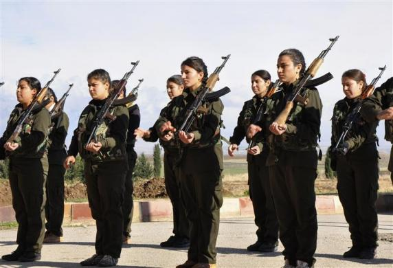 Kurdish female fighters of the Kurdish People's Protection Units (YPG) hold their weapons at a military training camp in Malikiya, Hassaka province December 9, 2013. Credit: REUTERS/Rodi Said