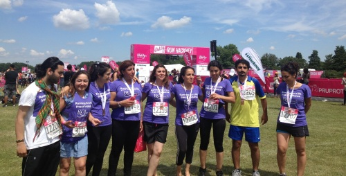Nine of Roj's eleven runners posed for a picture at the end of the half-marathon.
